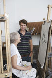 Man Looks At Mature Artist Draw Portrait Stock Images