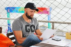 Man looks menu royalty free stock photography
