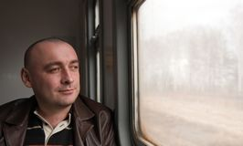 Man  looks out of the window trains Royalty Free Stock Photography