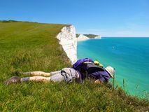 Man looks over cliff edge Seven Sisters, East Sussex, England Stock Images