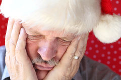 Man looks sad in Santa hat Stock Images