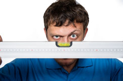 Man looks at the spirit level Royalty Free Stock Images