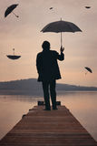 Man looks at sunset sky full of umbrellas Stock Photography