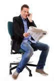 Man looks surprised while reading a newspaper Stock Photos