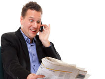 Man looks surprised while reading a newspaper Royalty Free Stock Photo