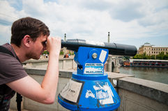 The man looks through telescope Stock Photo