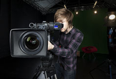 Man looks into viewfinder of a TV Studio Camera Royalty Free Stock Photo