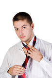 Man loosening his tie Royalty Free Stock Images