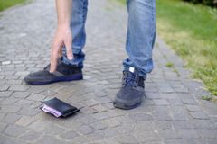 Man losing his wallet. On the street royalty free stock photo