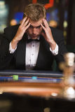 Man losing at roulette table. In casino royalty free stock photo