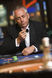 Man losing at roulette table. In casino royalty free stock images