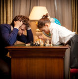 Man lost chess game with smart little gir Stock Images