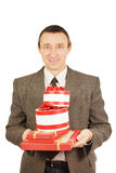 Man with a lot of presents Royalty Free Stock Photo