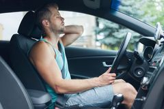 Man with back pain after a long drive in car. Man with lots of back pain after a long drive in car royalty free stock photos