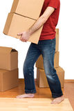Man with lots of cardboard boxes Stock Photography