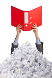 Man with lots of crumpled paper. On white stock photos