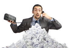 Man with lots of crumpled paper Royalty Free Stock Photos
