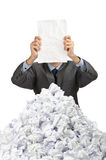 Man with lots of crumpled paper Stock Photo