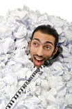 Man with lots of crumpled paper Royalty Free Stock Image