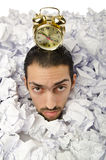 Man with lots of waste paper Royalty Free Stock Image