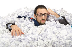 Man with lots of waste paper Royalty Free Stock Photo