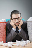 Man with lots of wasted paper Royalty Free Stock Photo