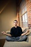Man in lotus pose Stock Photo