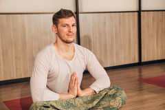 The man in the Lotus position Stock Photos