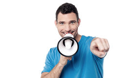 Man with loudhailer and pointing forward Royalty Free Stock Photo