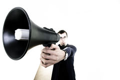 Man with loudspeaker. Young man with loudspeaker on corporate corridor royalty free stock images