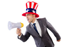 Man with loudspeaker. And american hat Royalty Free Stock Image