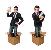 The man with loudspeaker in the box Stock Image