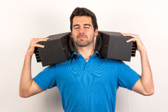 Man with loudspeakers on his shoulders enjoys sound Stock Image