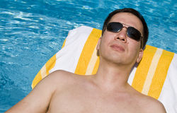Man Lounging by the Pool Royalty Free Stock Photography