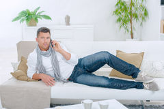 Man lounging on sofa Royalty Free Stock Photography