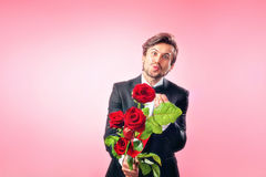 Man in love with a bouquet of roses Stock Photography