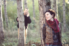 Man in love looking for his girlfriend in the forest. Enamoured man looking for his hiding girlfriend and calling her in the forest royalty free stock photo