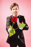Man in love with red rose. Man in love over the moon with red rose Royalty Free Stock Photo