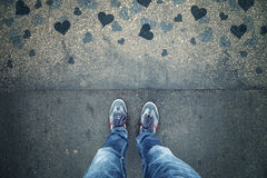Man in love standing on blue grunge heart asphalt floor royalty free stock photography