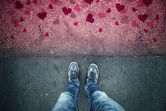 Man in love standing on red grunge heart asphalt floor Royalty Free Stock Photo