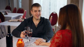 Man and love woman romantic evening in restaurant drinking wine , Valentine's Day. Man and  love woman romantic evening in restaurant drinking wine , Valentine's stock video