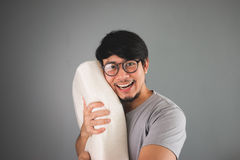 The man loves pillow. The man loves his pillow Stock Photography