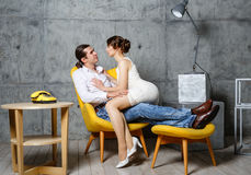 The man a loving couple embrace the woman in a chair royalty free stock image