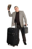 Man with luggage or greeting someone. Royalty Free Stock Photo