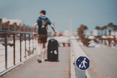 Man with luggage on summer sunny day stock image