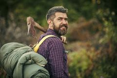 Man lumberjack happy smiling with axe and backpack Stock Photos