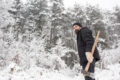 Man lumberjack in thermal jacket with ax. stock image