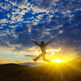 Man lumping on a sunset Stock Photography