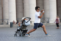 Man lunges taking picture in the Vatican City Stock Photography