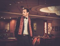 Man in luxury casino interior Stock Images